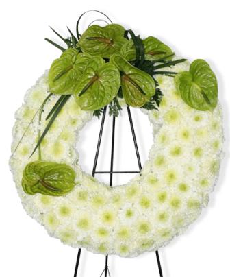 Corona funebre elegante con anturios